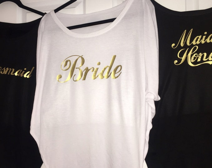 12 bridesmaid shirts . Bridesmaid loose flowy t-shirts. Bride, Maid of honor. Bridesmaid gold writing shirts . Bridal party oversized tops.