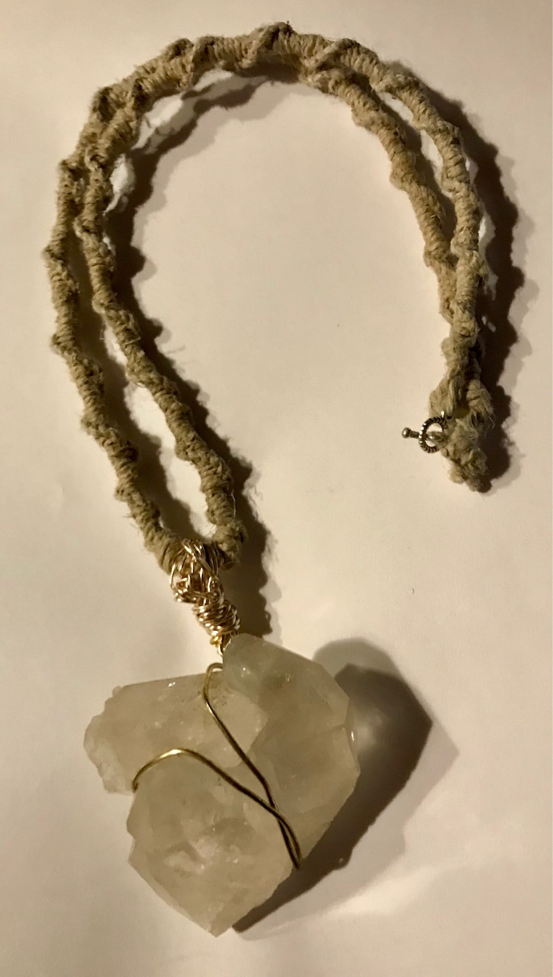 Double Crystal Tips wrapped in gold wire and attached to an 24\u201d all Natural Hemp woven  necklace