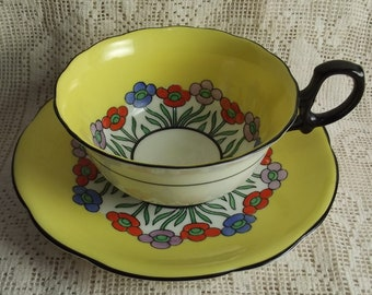 Rare Yellow Art Deco STAR Paragon tea duo has bright yellow with black accents and a black handle - floral elements outlined in black