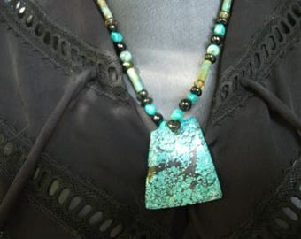 genuine carved turquoise pendant necklace.