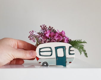 Small turquoise camper vase for plants. Perfect cactus or succulent planter