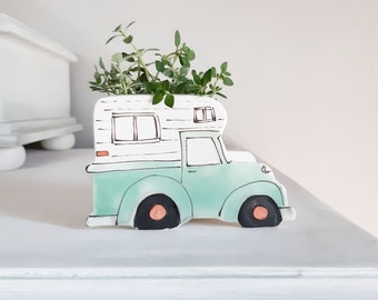Small old green vintage Pickup truck with camper ceramic planter. Old truck planter for cactus or succulent.
