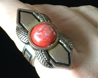 Funky fashion ring with orange setting