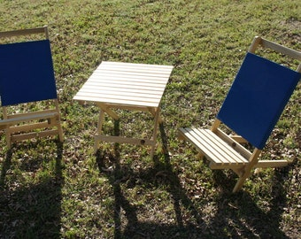 Two Blue Packer chairs and folding table the perfect combination for a relaxing day out at the beach or back yard