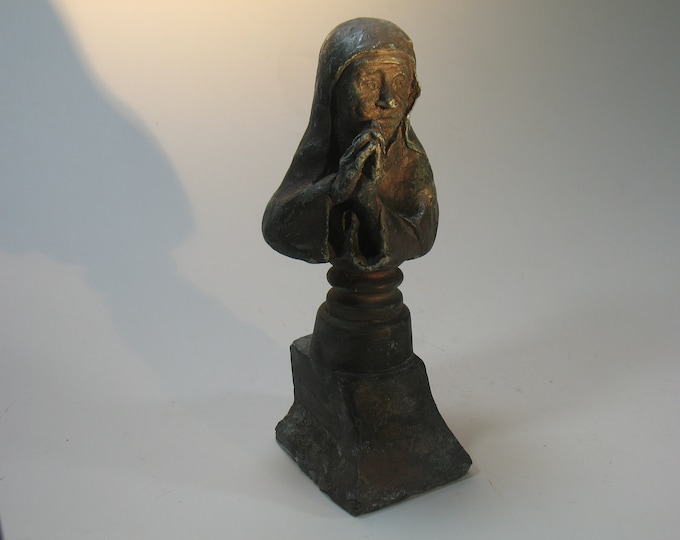 Mother Theresa bookend on pedestal