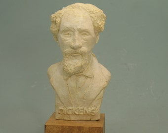 Charles Dickens bust - antique white on wood base