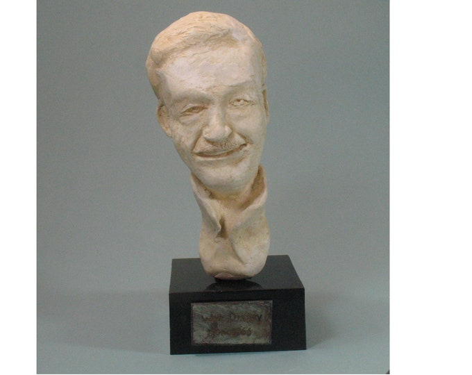 Young Walt.  Bust of Disney as a cartoonist