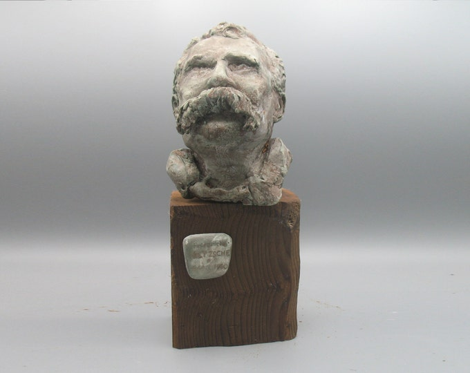 Featured listing image: Friedrich Nietzsche as blind Tiresius - rough-cast metallic finish on timber
