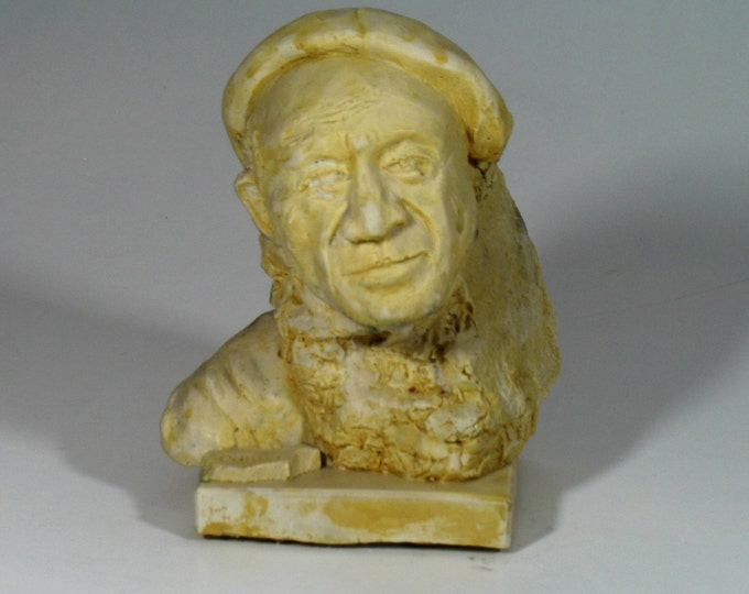 Picasso emerging from a rock.  Pablo Picasso bust in hydrocal, antique white