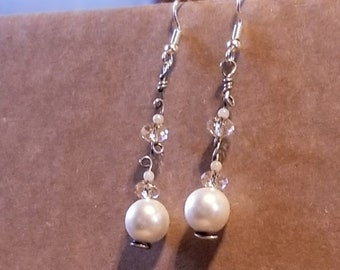 Elegant Pearl drop earrings include crystals rondels on  a sterling silver wrap  create a 1 3/4 inches drop.  Very classic with any fashion.