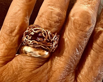 Here is a precious 8mm square cut amethyst wrapped into a beautiful rose gold filled nest.  Definitely a statement ring, it is a size 7 US.
