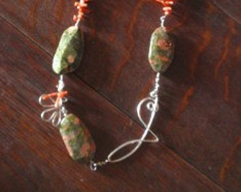Beautiful Coral and Unakite nugget necklace with fine silver feature asymmetrically placed on the left.  24 inches long.