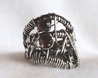 Forged, wrapped sterling silver statement ring set with 5mm axionite and chrome diopside untreated stones  1 inch wide top, size 6 1/2.