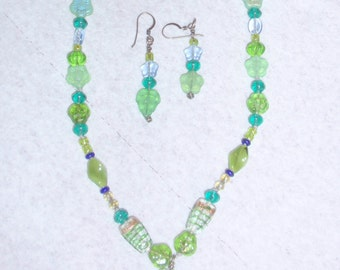 Soft Blues and greens pressed glass beads.  Matching  asymmetrical earrings.  A lovely pastel pair.