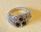 Sterling filligree ring with gorgeous rich red natural garnets, JANUARY BIRTHSTONE. Wraped on a sturdy forged band. Size 7