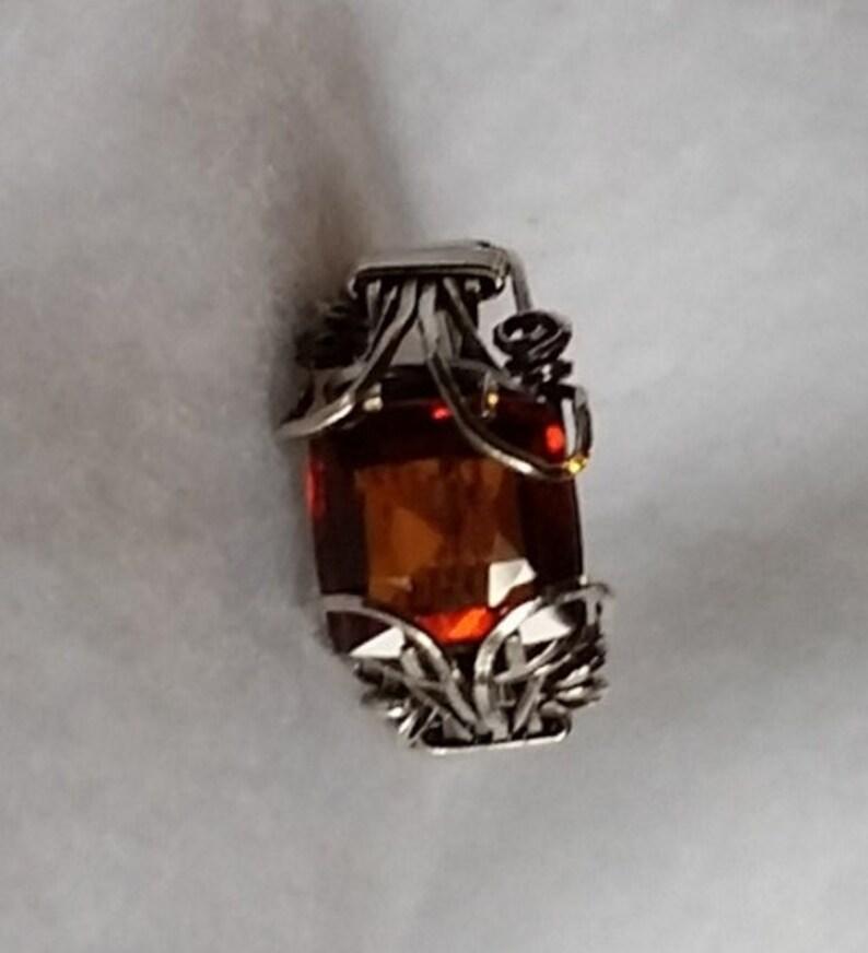 Genuine Red Hessionite Garnet 10 x 10 Cushion cut 4.7 carats. image 0