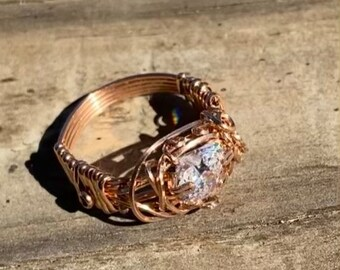 A diamond white CZ heart wrapped in rose gold makes a lovely promise ring. This size 7 ring features a prong set heart cut CZ filigree set