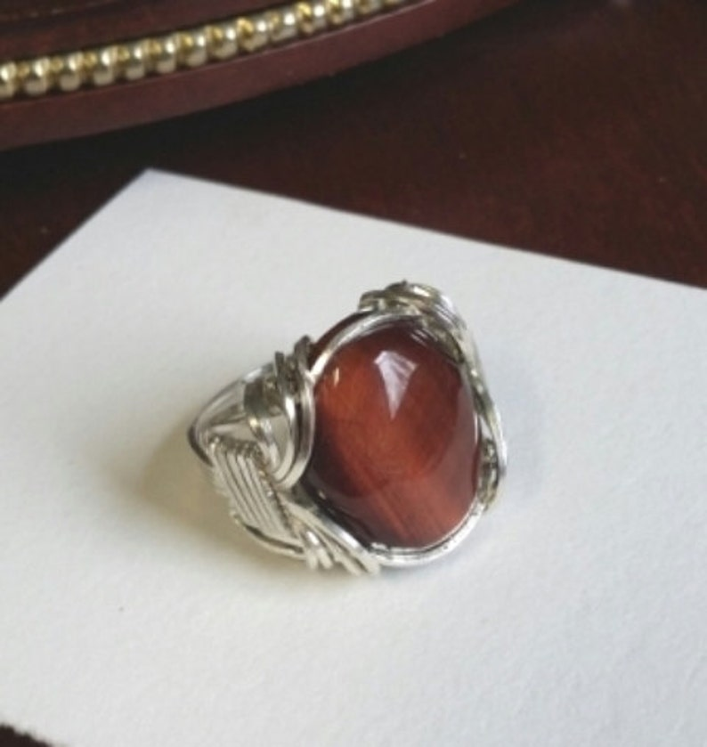 Beautiful Red Tigereye Cabochon stone set in a traditional image 0