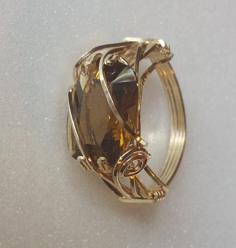 Whisky Quartz is a natural stone here cushion cut and set image 0