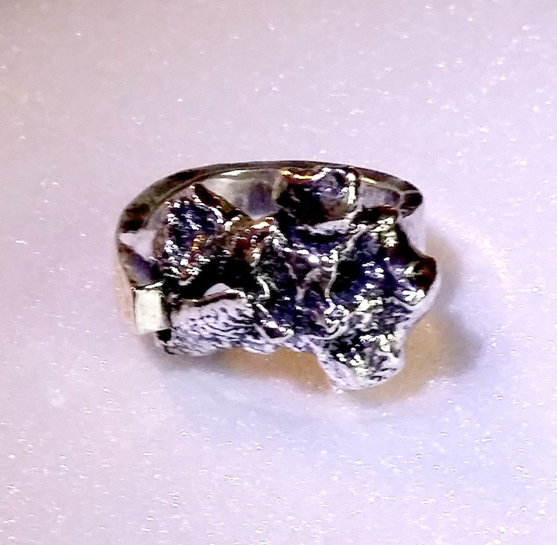 Forged sterling silver ring with fused reticulated design. image 0