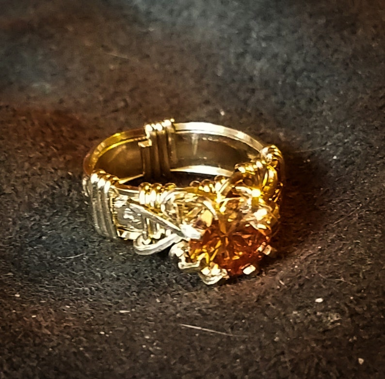 Beautiful Dark Champagne color CZ is set in yellow gold on a image 0