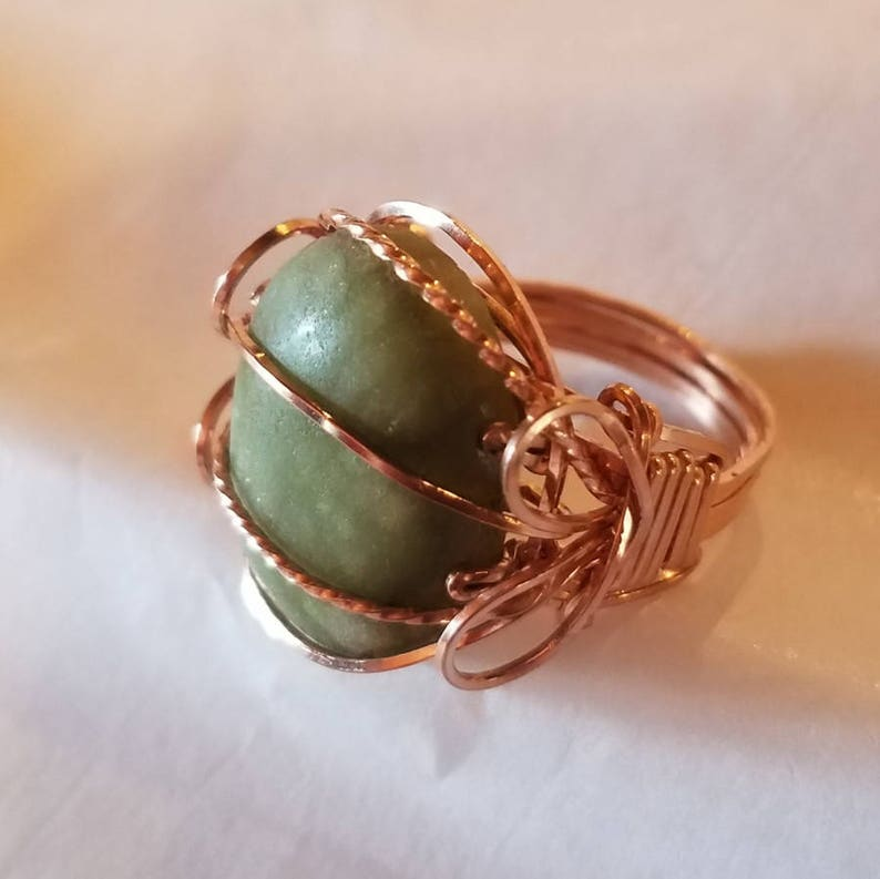 Style conscious rose gold wraps a smooth green cabochon image 0