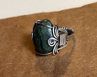 Serpentine cabochon ring set in the Pharoah style.  Sterling  silver wrap is tailored in a clean style that will lend itself to daily wear.