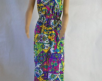 SALE!! Was 42.00 now 25.00. 1960's Fabulous print maxi dress with open back. Size medium