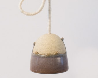 Decorative hanging bell, for indoor or sheltered outdoor use.