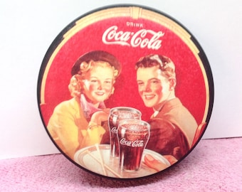COCA-COLA TIN is a Vintage 1989 Decorative Black & Red Collectible Round Coca-Cola Low Tin Container with a Young Couple Out to Enjoy a Coke