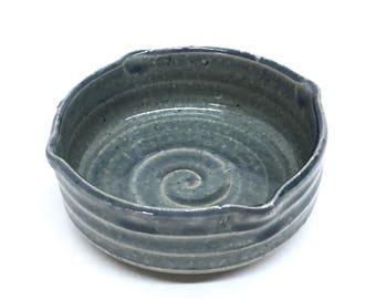 BLUE POTTERY BOWL is a Glazed Ribbed Ringware Ceramic Stoneware Brush Pot / Paint Dish in a Mottled Denim Blue Round Snail Shell Like Design