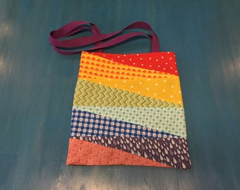 Rainbow Tote Bag with black lining, purple belt straps, colorful side bag!