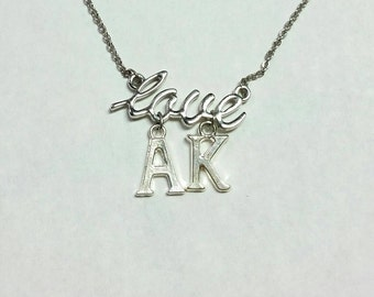 Silver 'Love Ak' necklace on 16 inch chain
