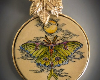 Dogwood scrimshaw on mother-of-pearl with vintage button back GF wire