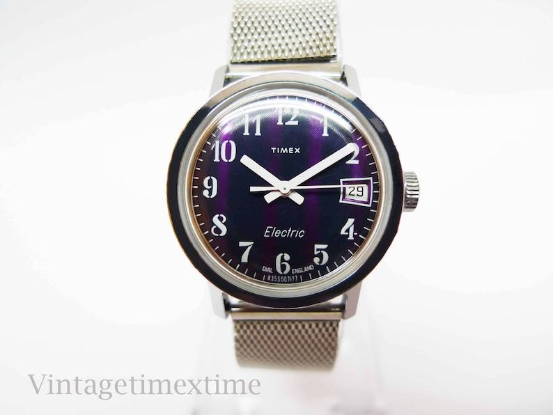 4b30626bb946 Timex 1977 Electric Woman s Watch 2 Tone Purple Dial
