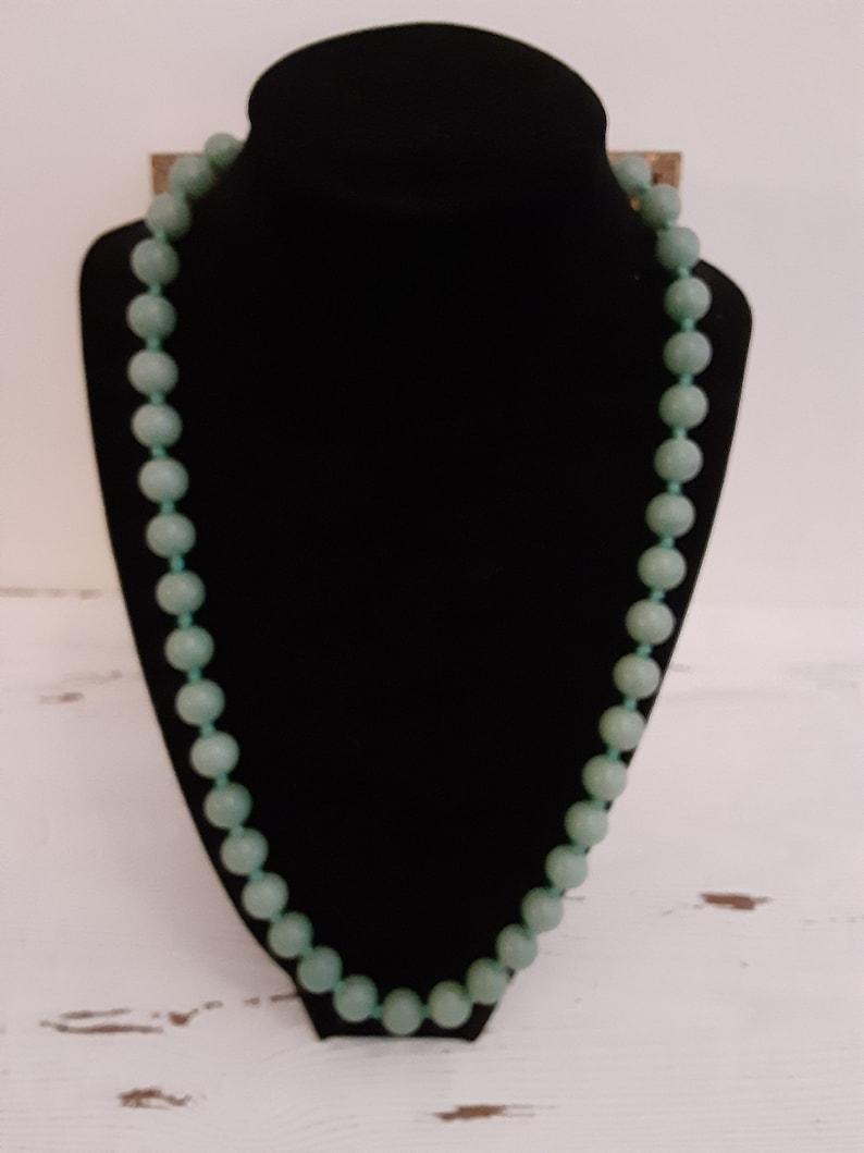 Mid century Jade bead necklace silk string light green