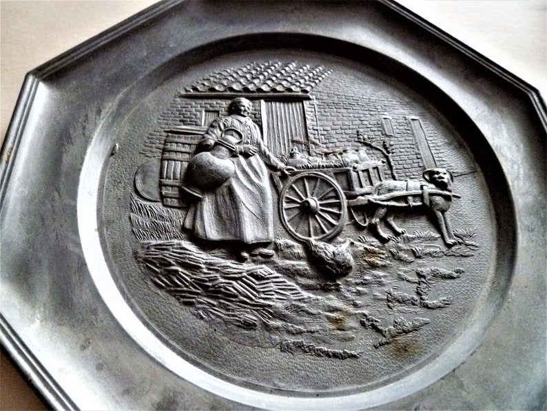 full carriage with products and loose chicken and dog ready to haul big Vintage Pewter Plate depicting Farm Lady carrying Huge Milk Jar