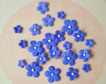 36 fondant flowers made by FancyTopCupcake.