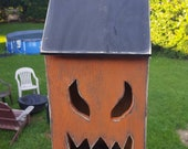 Handmade wooden jack o lantern saltbox house with clip light hole in the back
