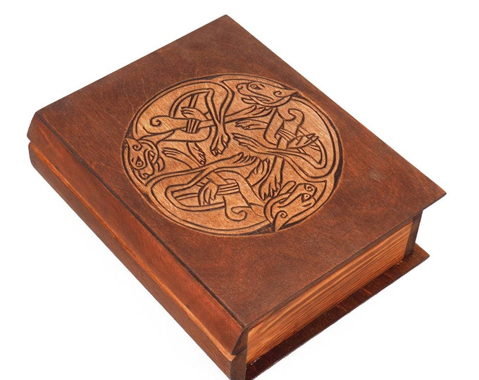 Historical wooden box in the shape of a book with  3 Dogs Book of Kells