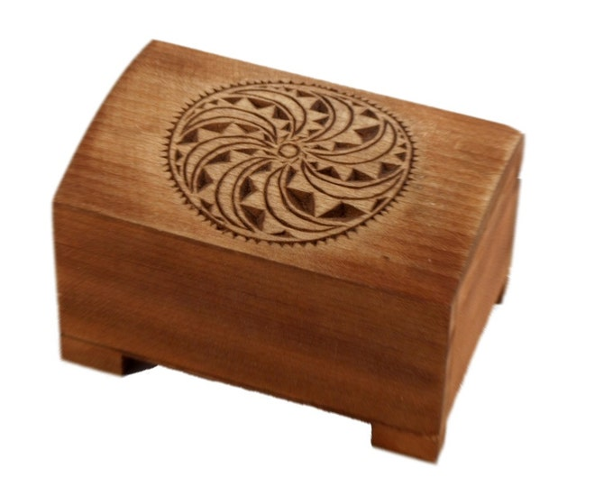wooden historical jewelry box with solar symbol