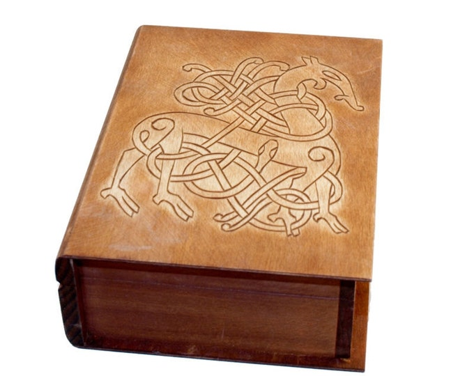 Historical wooden box in the shape of a book with Urnes Dragons