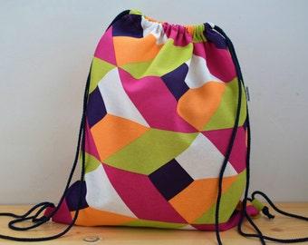 String backpack,geometric backpack,colors print fabric,geometric fabric,fabric backpack,draw string backpack,draw string bag,pink backpack