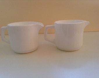 Set of 2 Vintage milk glass pitchers by Arcopal France