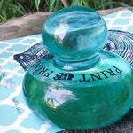 A Bären Glass Printmaking   Hand tool   Recycled glass   Best device for making relief & intaglio prints   Fold heavy paper   Paper weight  