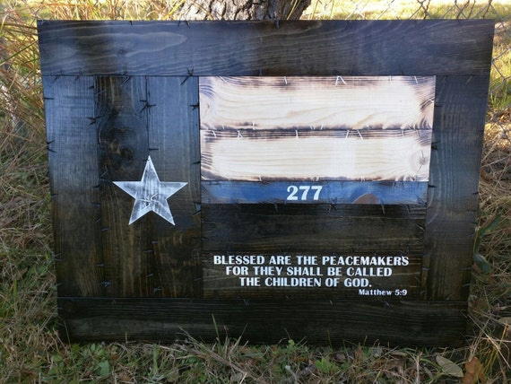 Framed thin blue line Texas flag with Peacemakers verse