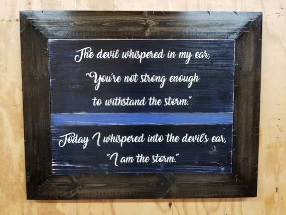 "Framed Wooden Rustic-Style Thin Line ""I am the storm."" Sign (25""x31"")"