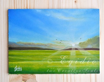 Small oil painting with sunrise on a green lawn Painting with sunbeams at sunrise in spring Light blue green