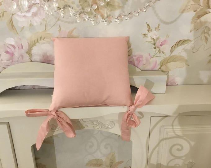 Pink bow cushion
