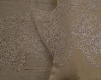 Ivory lace. Chantilly lace. Edge for wedding dresses, curtains, tablecloths.